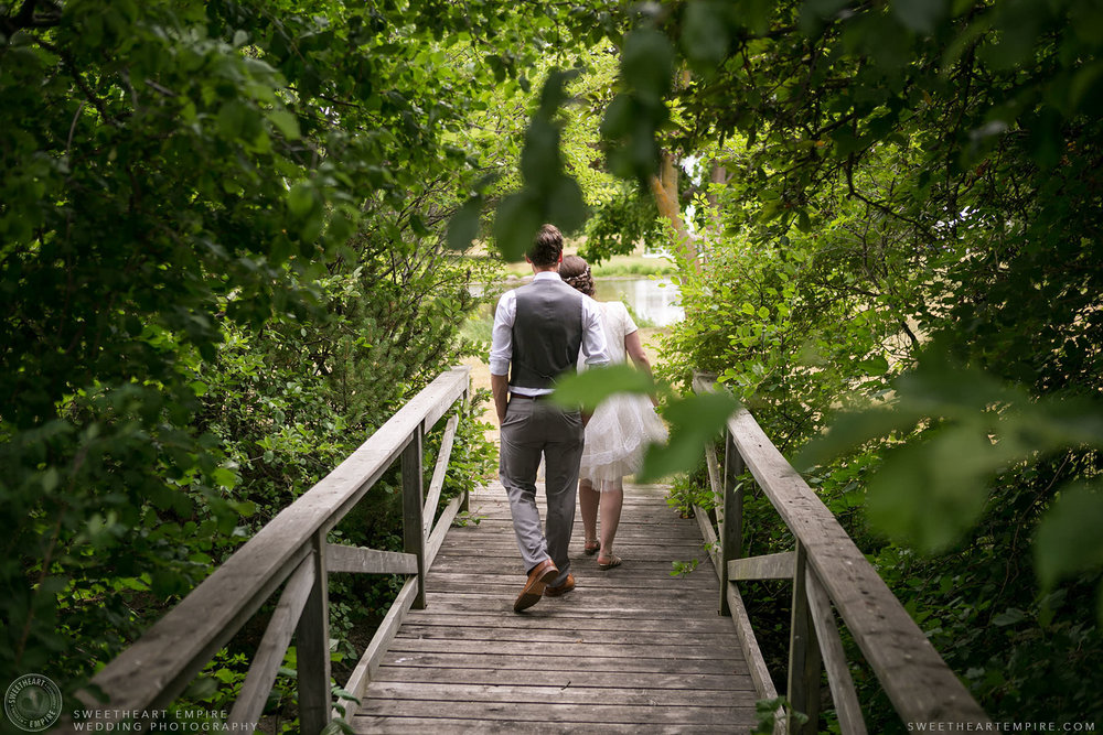 Bride and groom walking together outside; Aberfoyle Mill Wedding