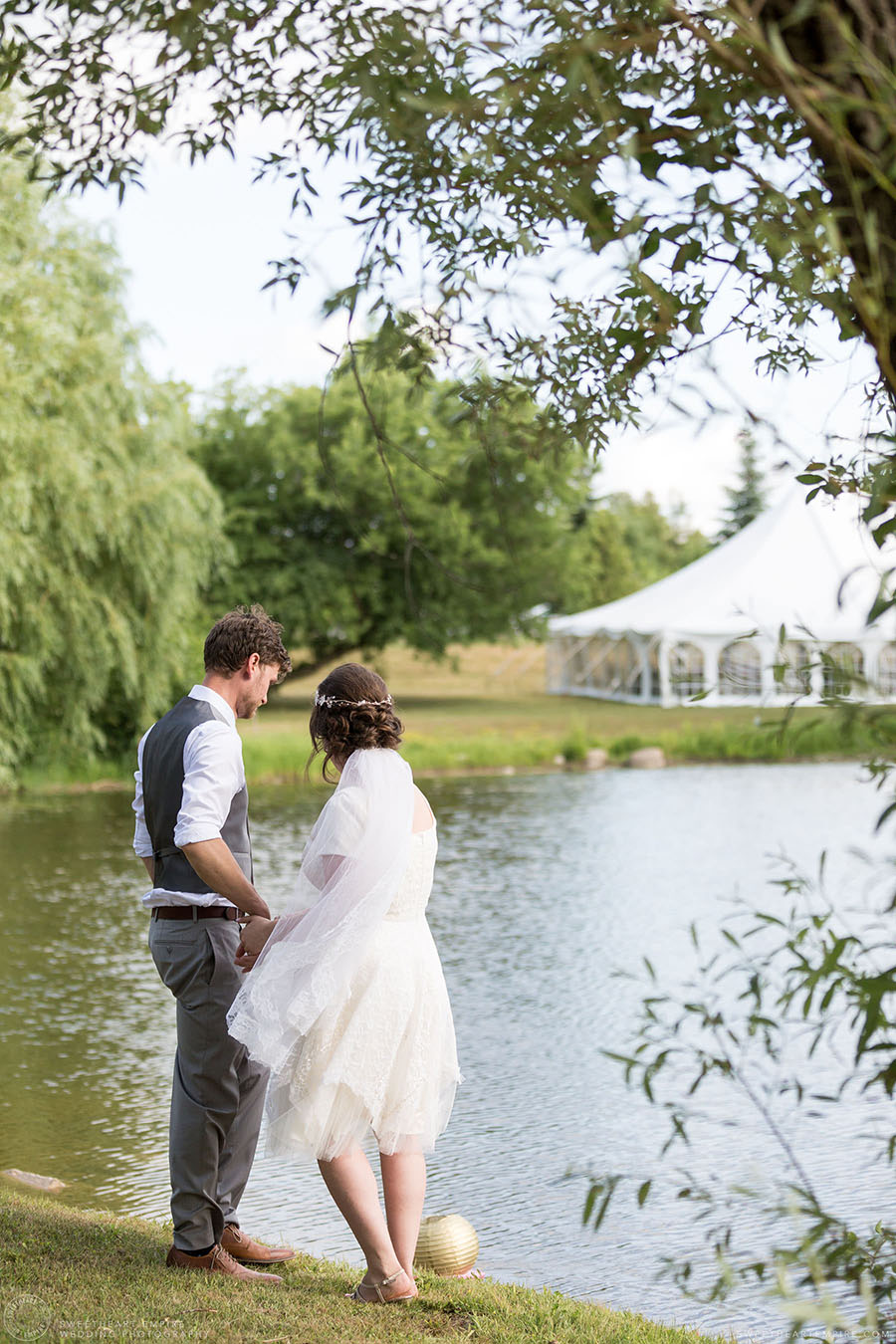 Bride and groom by the water; Aberfoyle Mill Wedding