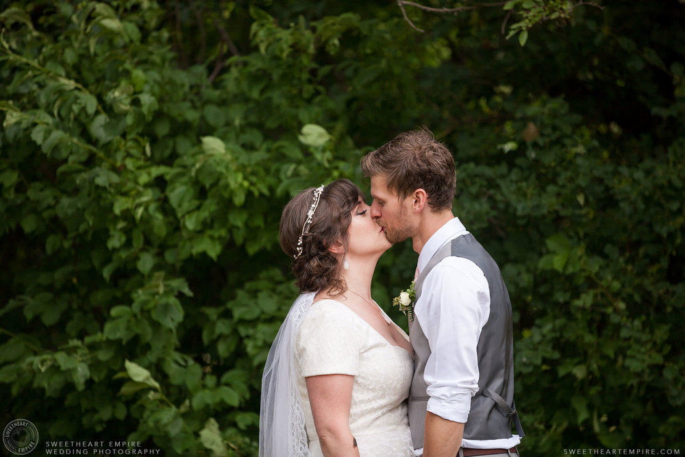 Bride and groom kiss; Aberfoyle Mill Wedding