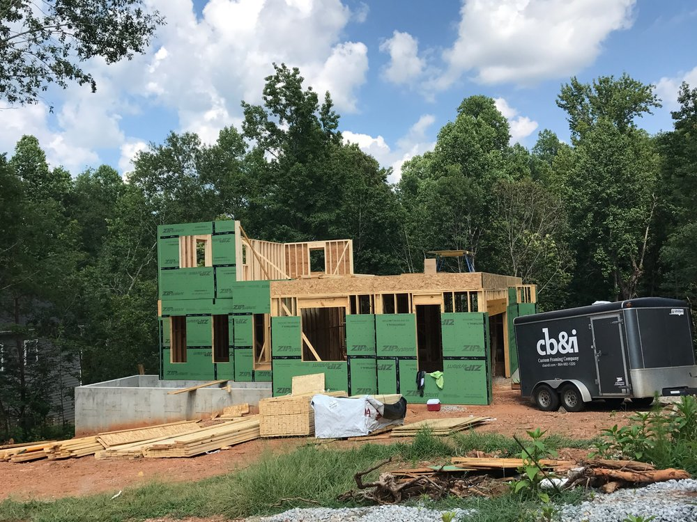 Second Floor system in and walls going up. We really enjoy using cutting edge products like the Zip System which combines the wall sheathing and vapor barrier into one easy to use product.