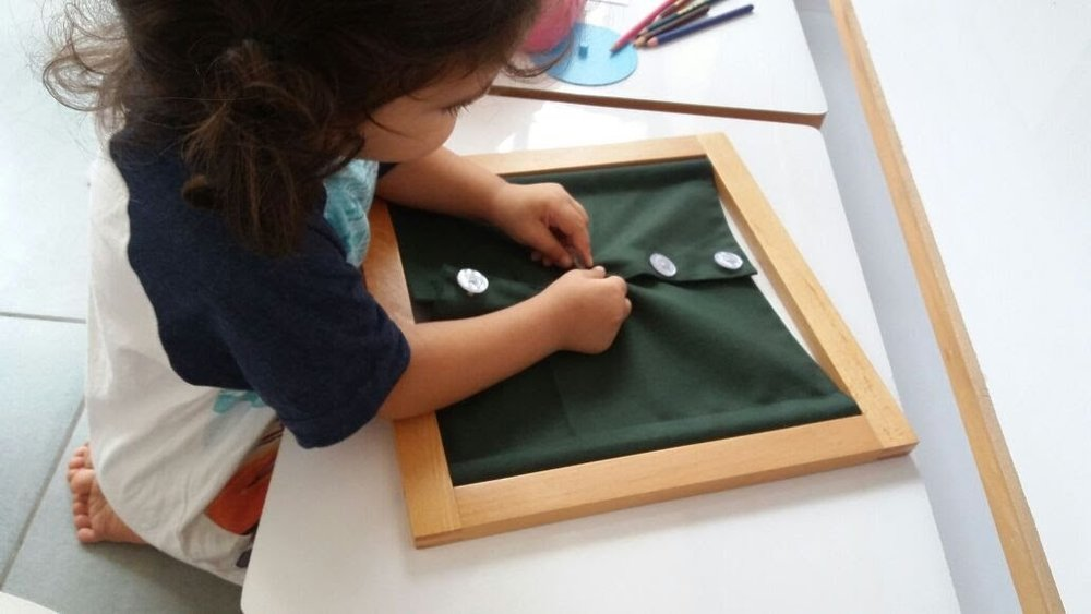 Using the button frames to practice fine motor skills