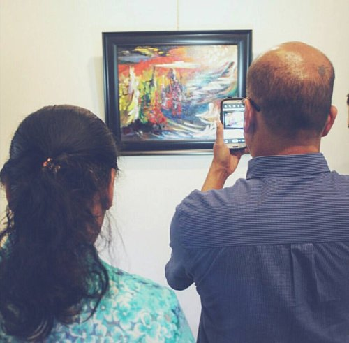 My parents at my first exhibit, 2015