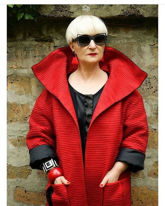 Photo     Red coat, sunnies and attitude.  Love it.