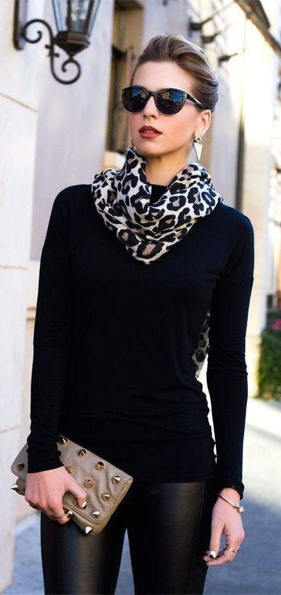 A touch of leopard print, such as in a scarf on a black monotone style adds elegance.   Photo