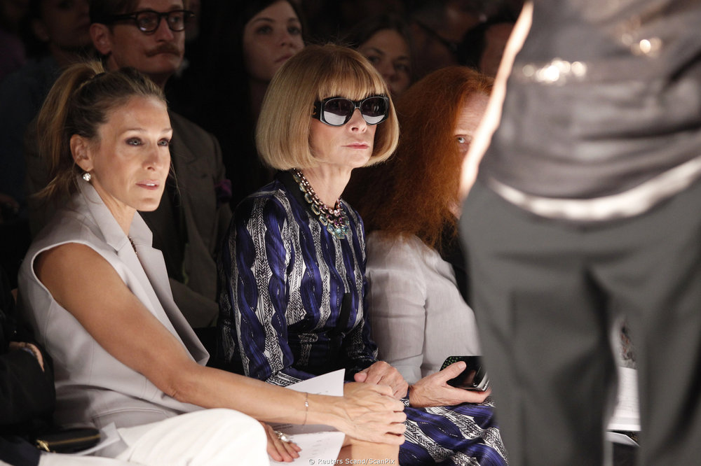 Anna Winter with Sarah Jessica Parker watch the Narciso Rodriguez 2011 Spring Collection.   Photo