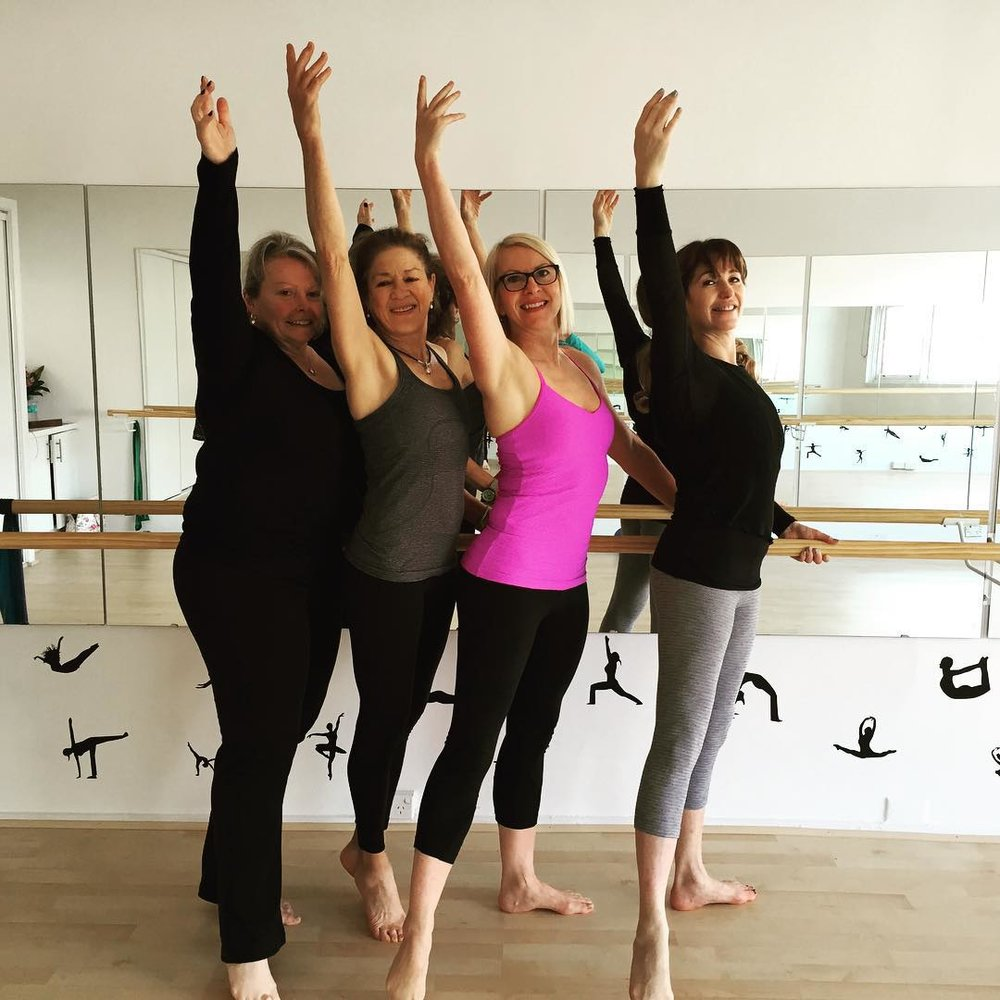Wendi teaching a Barre Attack class.