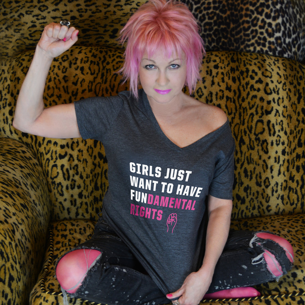 """Inspired by the menagerie of protest signs using this empowering slogan during the worldwide Women's March in January,Cyndi Lauper has released a t-shirt """"Girls Just Want Fundamental Rights"""" for her True Colours Fund and Planned Parenthood.    Purchase your t-shirt here."""