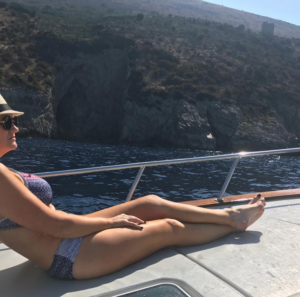 "In my own little world, on our private boat in the Amalfi Coast.  I have finally learn't to celebrate my curves, which has taken me a long time to do.    Love these bikinis designed for ""luscious babes with curves"" from  @sunseekeraustralia"