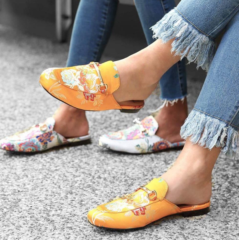 We are in love with these colored floral mules. Photo Credit:  Instagram Mollini Shoes