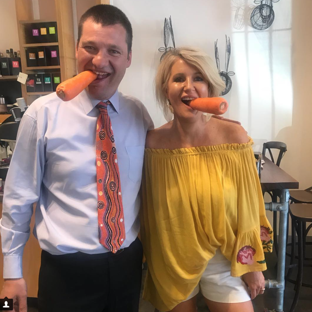 Michael and Caz having some fun with carrots after a healthy lunch.
