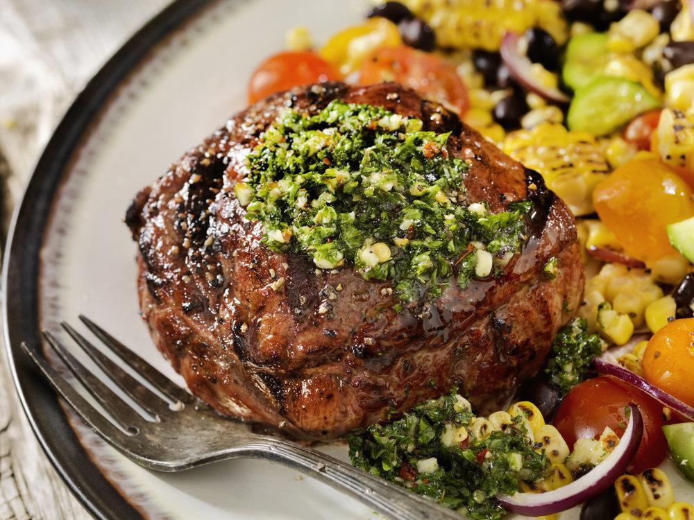 Top steak or chicken with pesto.