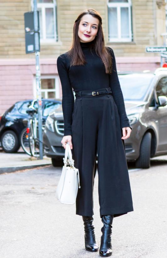 All black winter outfit. Black culottes, black overknee boots, black turtleneck.   Image