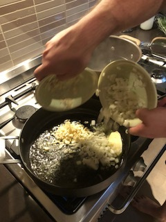 Place 4 tablespoons extra virgin olive oil, 2 tablespoons of butter, 1 diced brown onion and 6 diced cloves of garlic into a pan.  Sweat off on a low heat.
