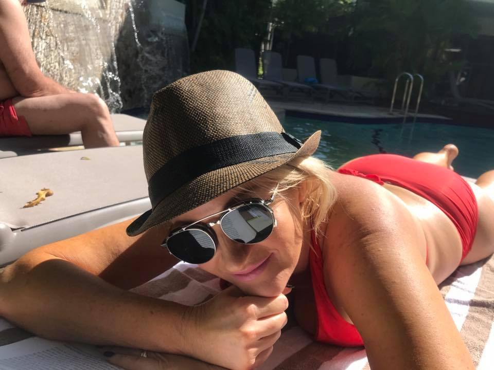 Adding a touch or vitamin D and relaxing by the pool and being photographed by my husband.