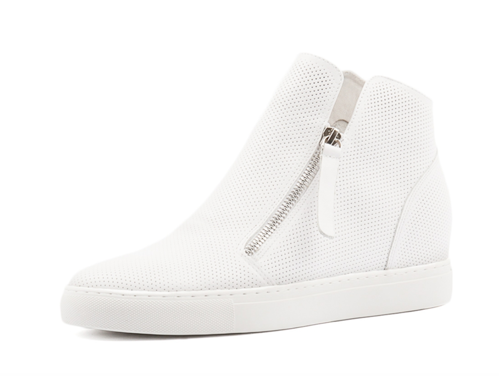 A classic twist style I love, but one I am not sure is going to stay. This is why I wouldn't invest a lot on this style, so this pair of Django and Juliette's Gisele white leather boot at $169.95 is perfect. From  Styletread.
