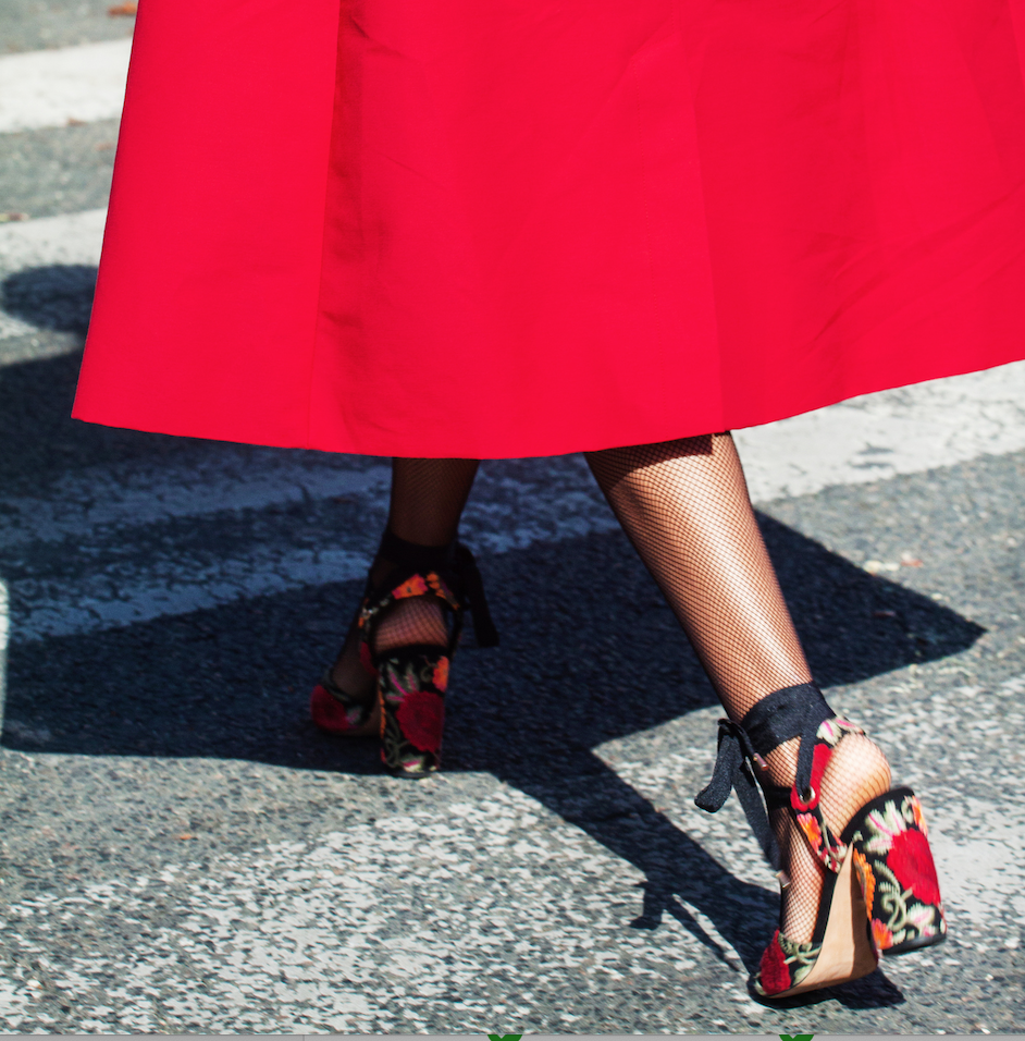 Red shoes are always popular on the streets of Paris.