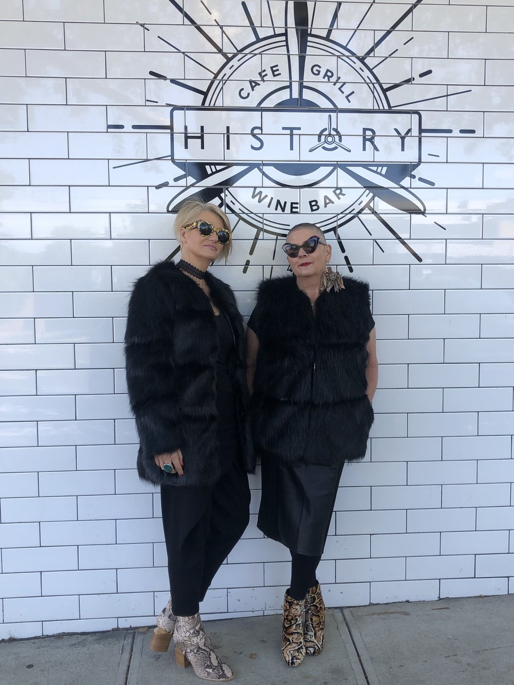 Two stylish women who are comfortable in their own skins. Caz in the over 50's and Claudine in the over 60's wearing Cazinc The Labels Faux Fur Coats.
