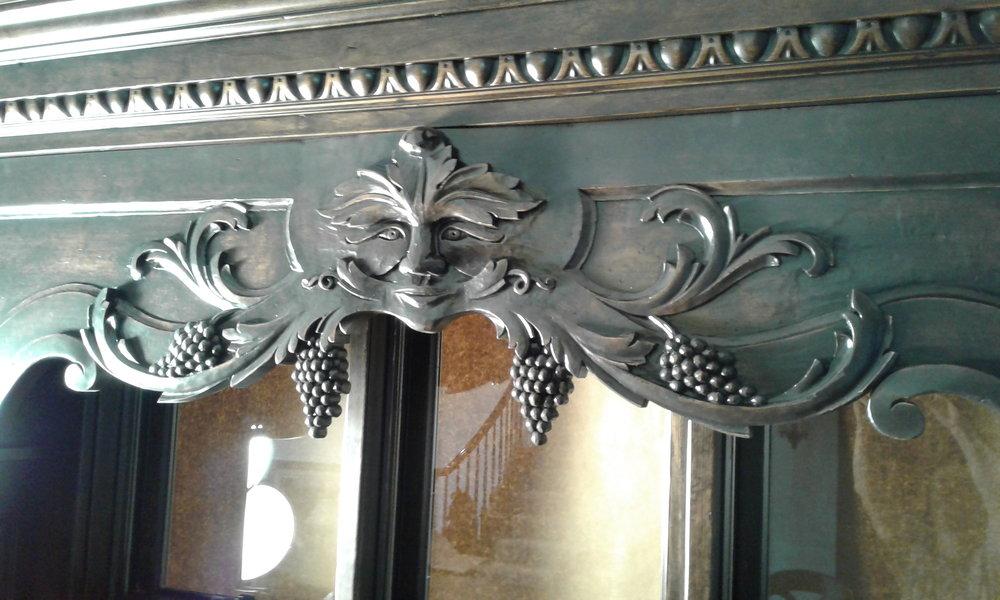 A custom, carved wood, bar valance