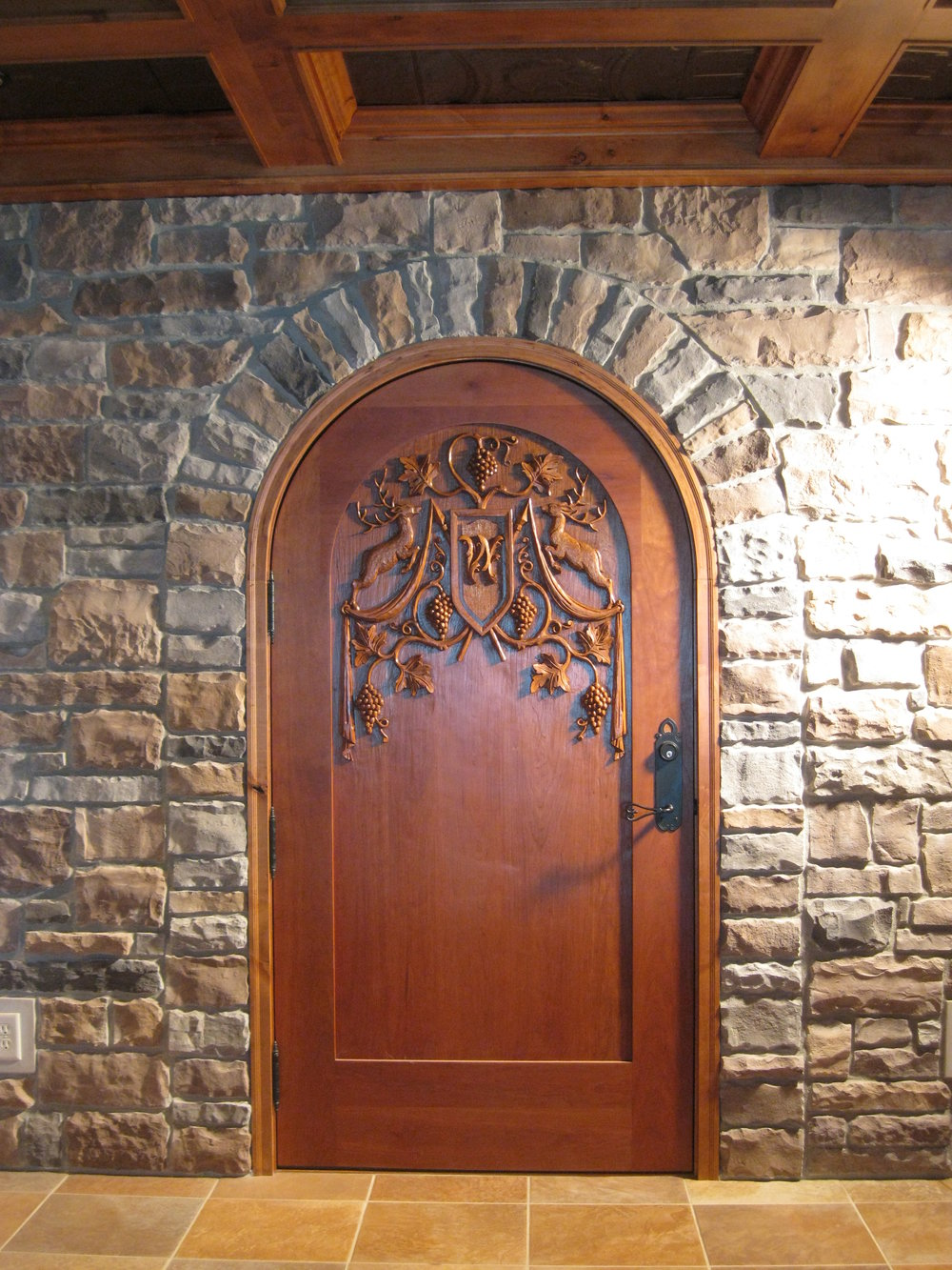 Carved cherry wine cellar door