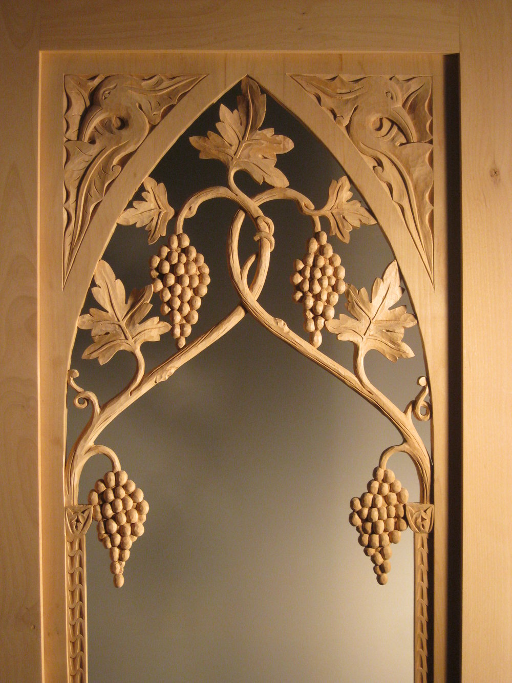 Abby,  carved wood and glass wine cellar door. (detail)