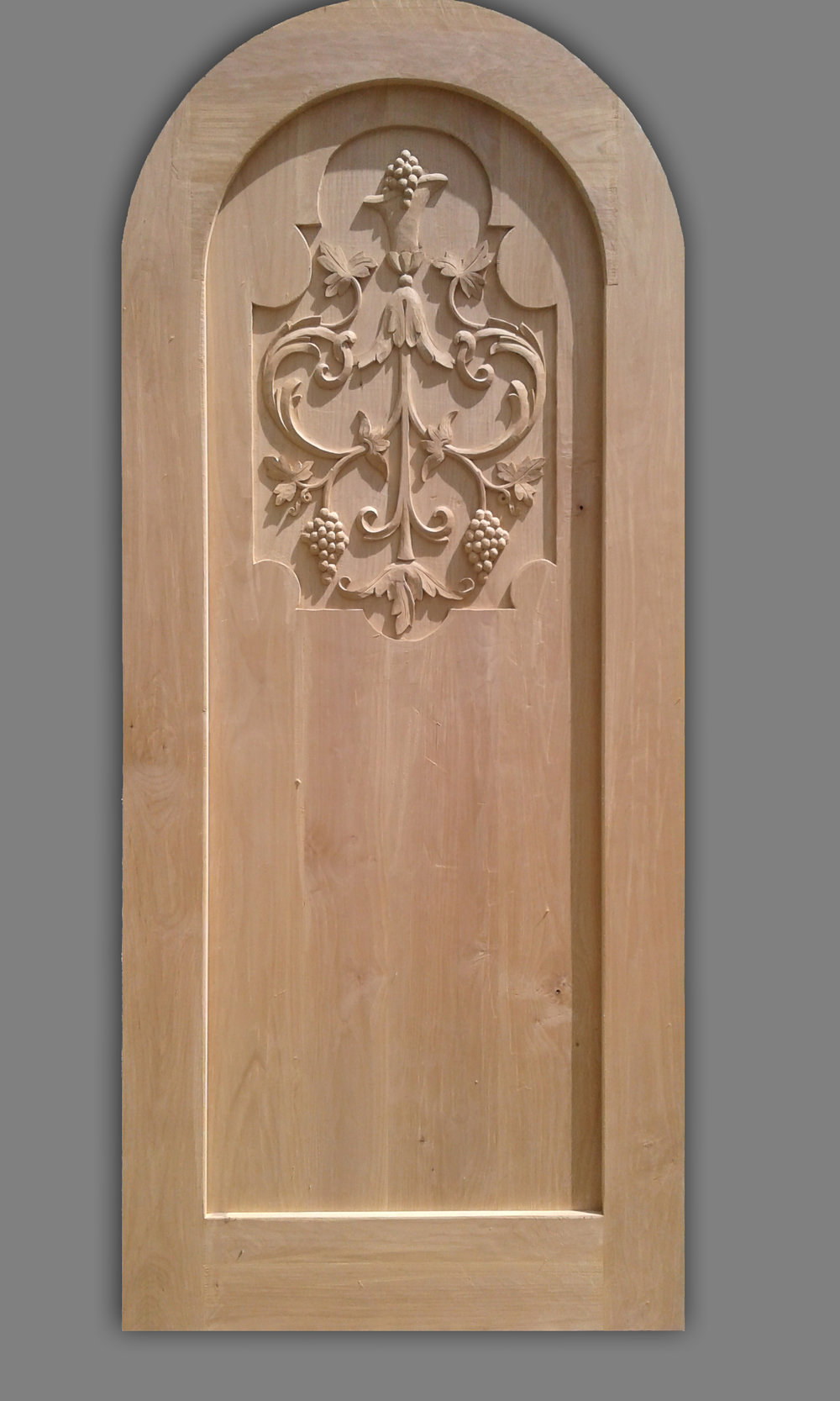 Roma, carved wood wine cellar door.
