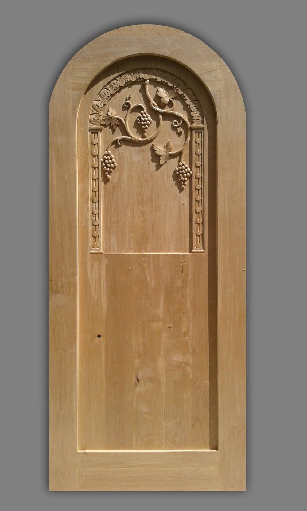 Florence, carved wood wine cellar door.