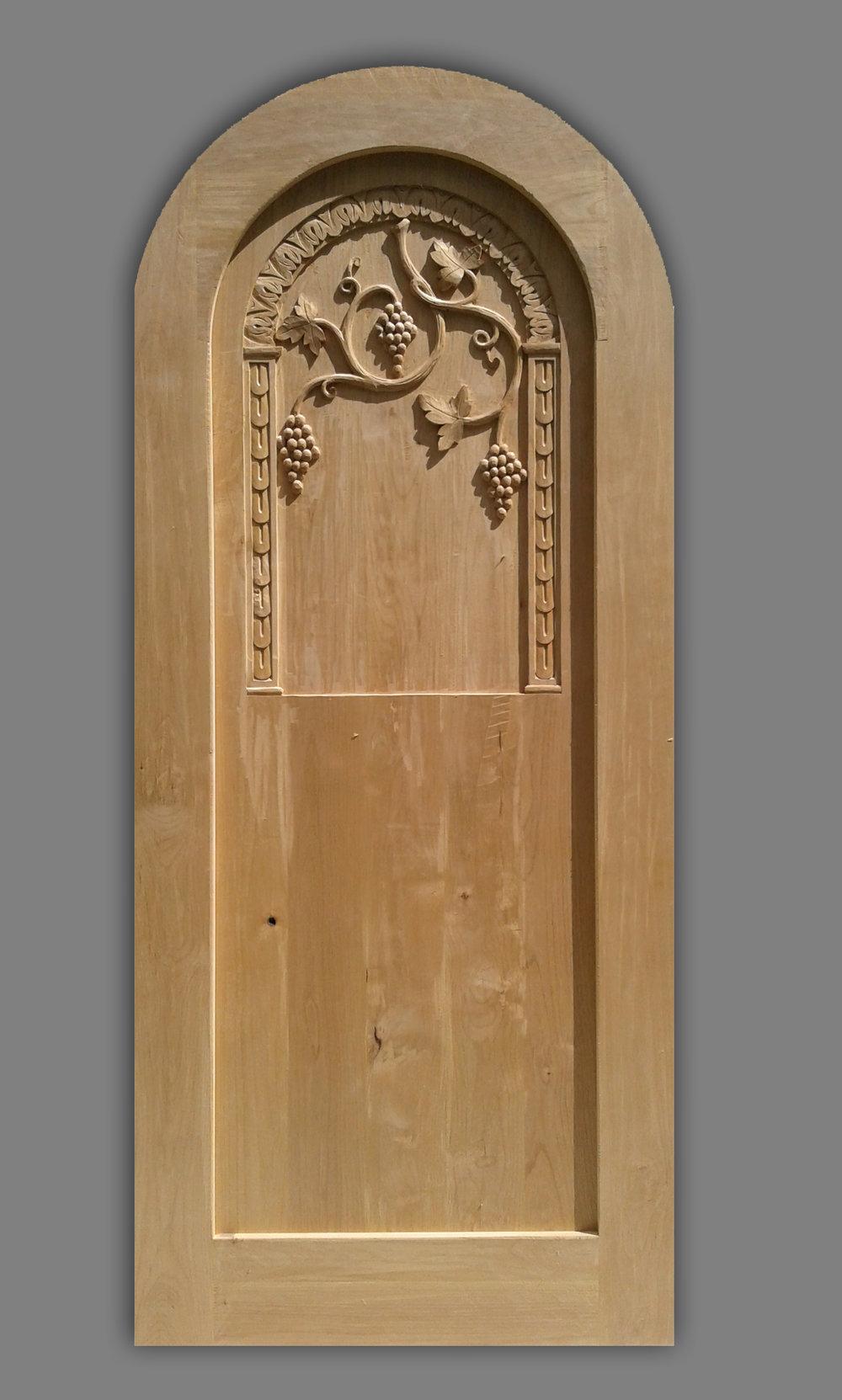 Florence, carved wood wine cellar door.