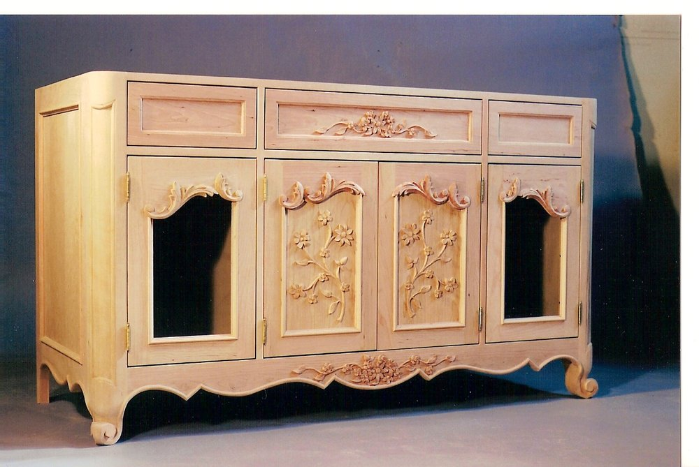 a hand carved, French Country vanity