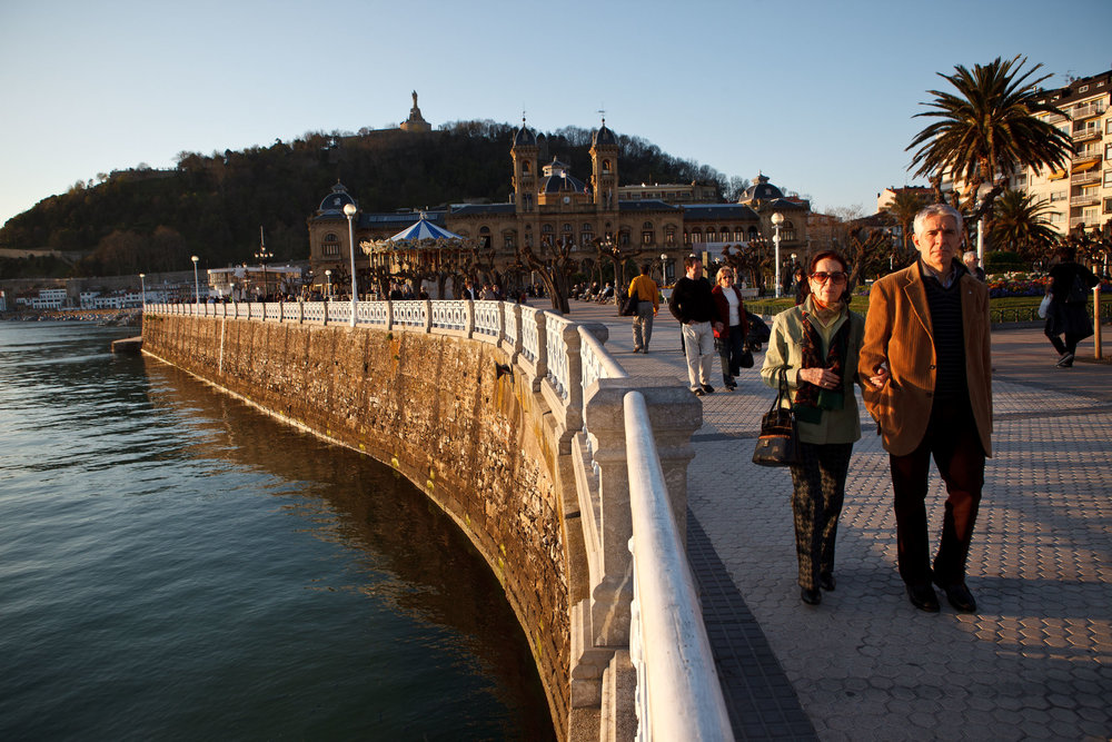 Paseo, or evening stroll, along path behind La Concha Beach,  San Sebastián, Spain.