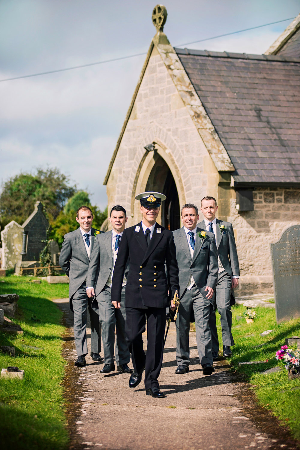 Groom and groomsmen walk | St Cynfran Church
