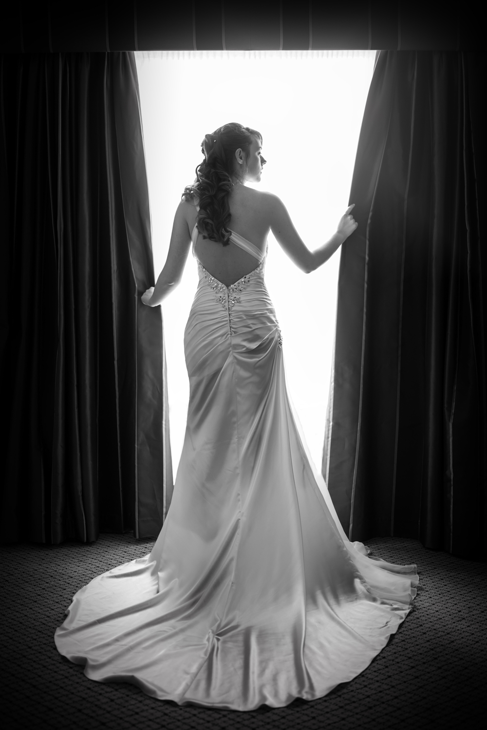 Bridal portrait window shot  at the Hilton Avisford Park | Sussex Wedding
