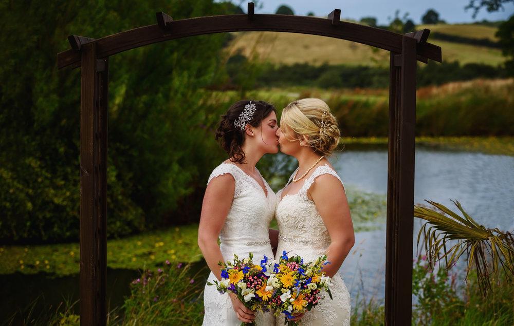 Brides walking through confetti | Same sex wedding at Ox Pasture Hall | Yorkshire