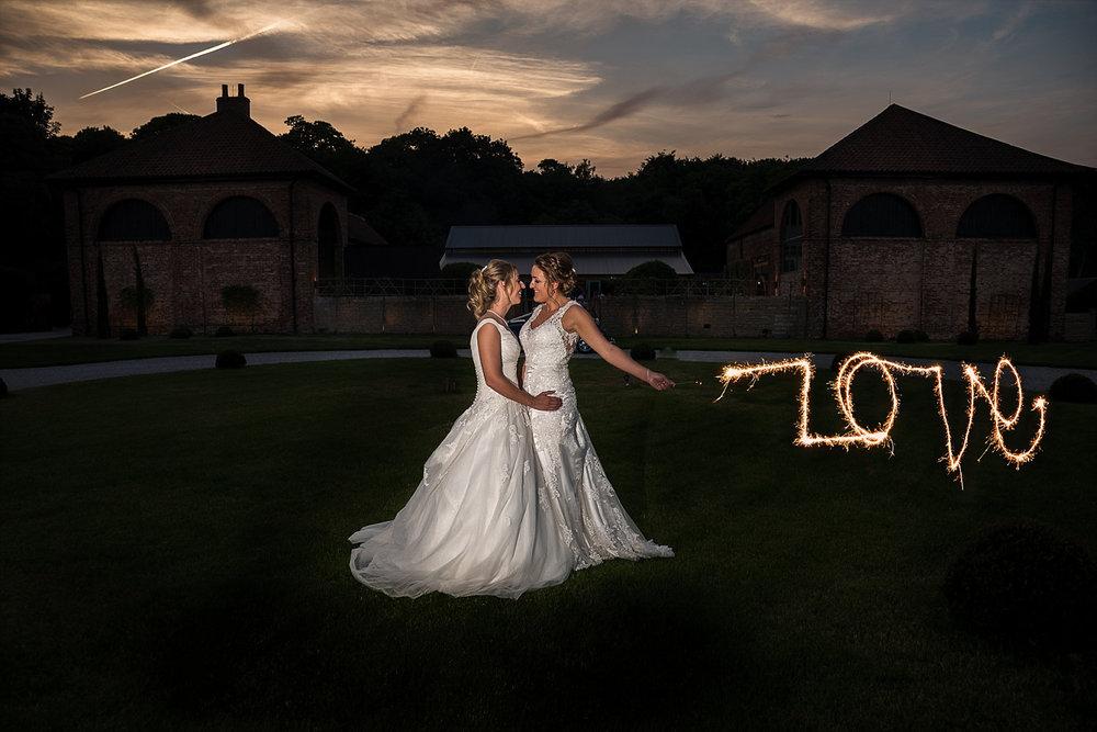 Dramatic sunset photo LGBT wedding
