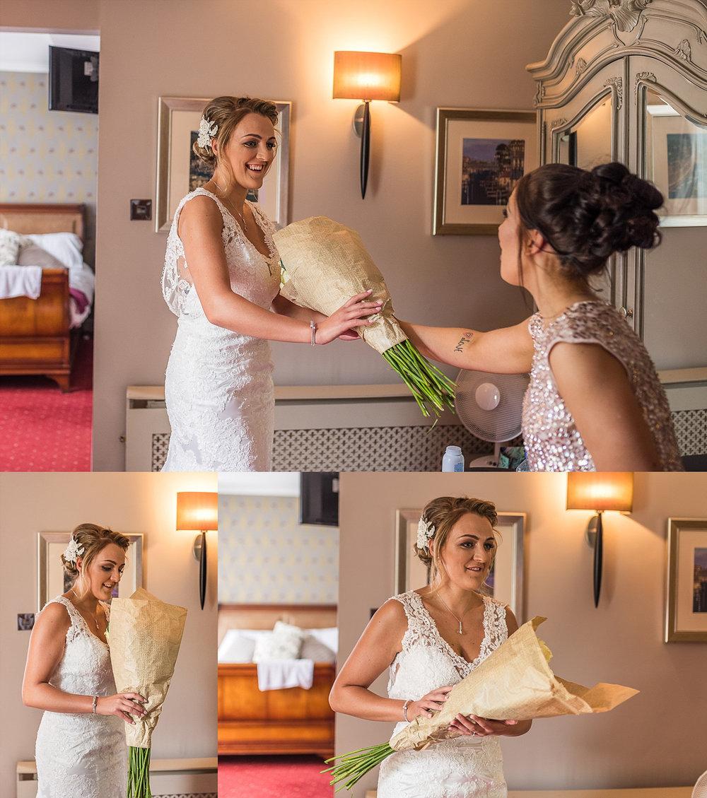 bride receiving flowers during bridal prep