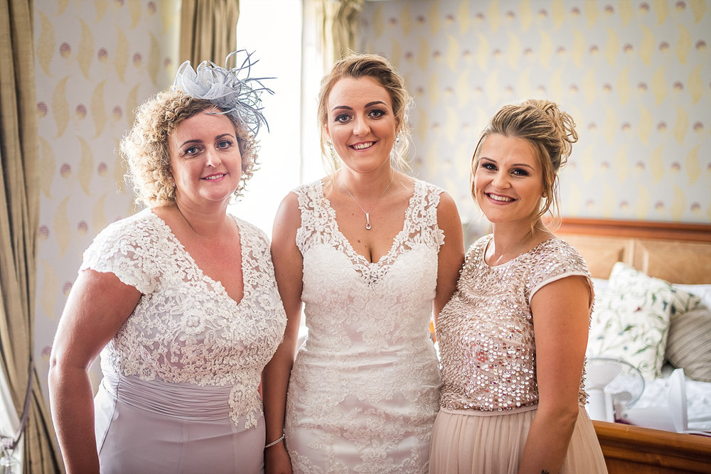 bride with MOB and Maid of honour
