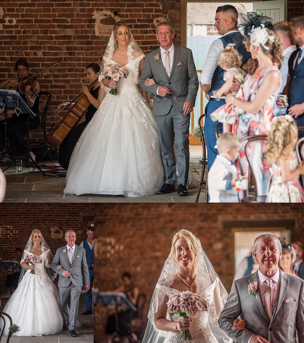 tearful moments of bride walking down hazel gap barn aisle