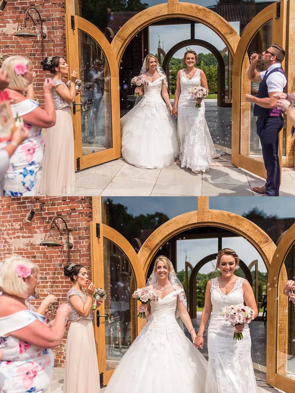 Bride and Bride walking through bubble exit after ceremony