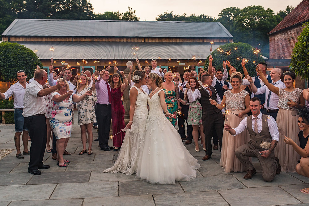 Brides celebrate with sparkler exit Hazel Gap Barn