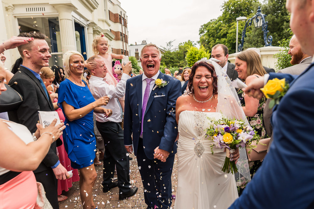 fun and exciting wedding   Bride and groom leaving venue for confetti walk   Glenmore House