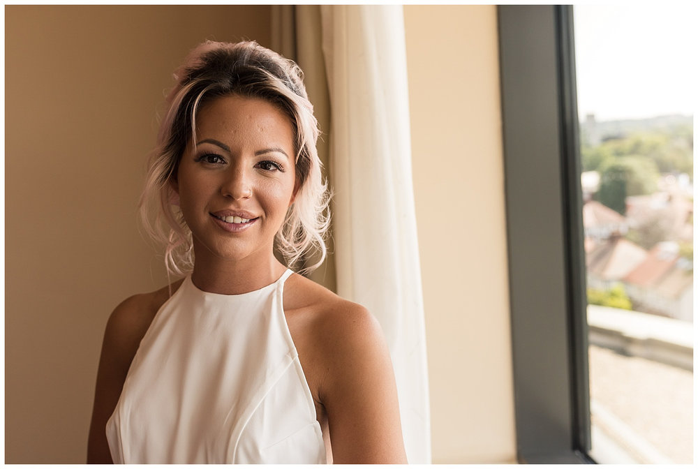 Bridal portrait window shot  at the Marriott Hotel | Surrey Wedding
