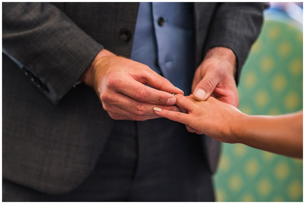 Exchanging wedding rings | York House Wedding Photography