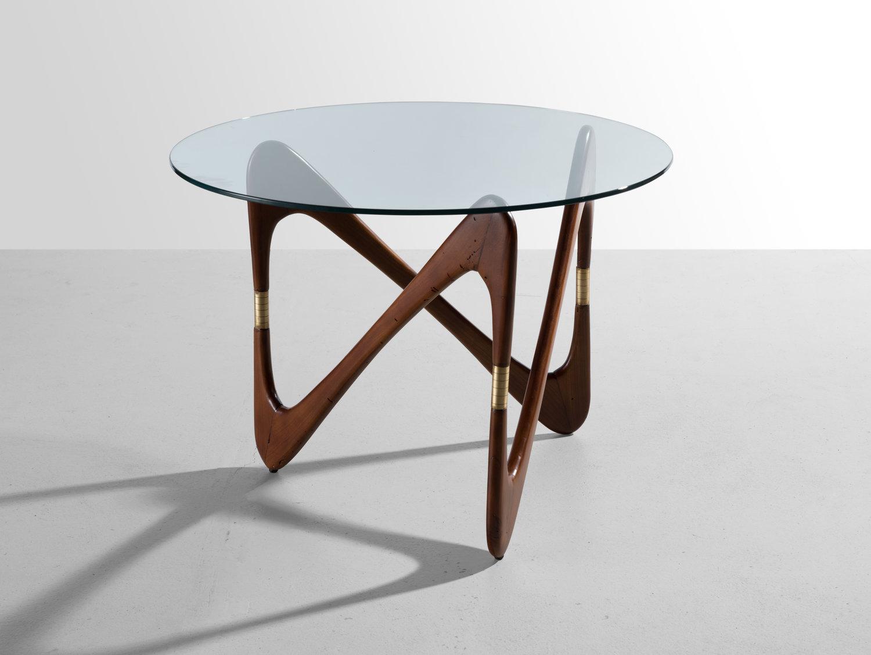 Кофейный столик c фигурным основанием , 1950-е (приписывается Чезаре Лакке). Эбеновое дерево, полированная латунь, прозрачное стекло