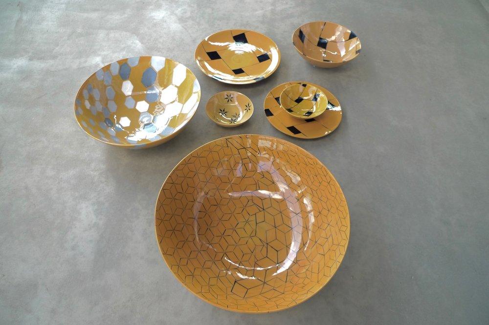 design on terra cotta bowls: 16x36cm (350E), 9x26cm(200E),7x20cm (60E),3x13cm (40E) plates 28cm (80),22cm(40E)