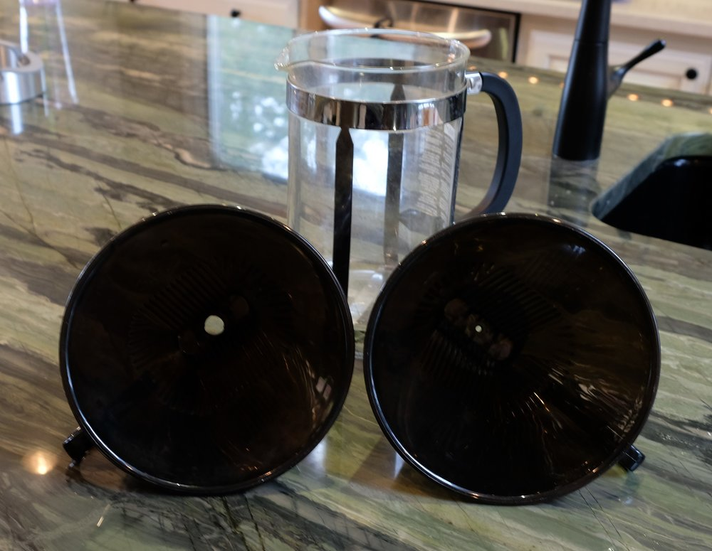 The larger hole in the cone on the left speeds up the process, while the original hole on the right is important if you are going to make coffee with the Melitta, sized to allow the extraction of flavor as the coffee slowly passes through the filter.