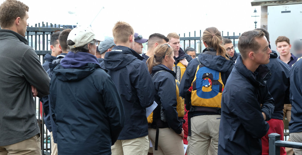 Naval Academy midshipmen are briefed as to their role in the day's sailing and racing programs. If possible, we will get four races in before we have to return to the Sailing Hall of Fame.