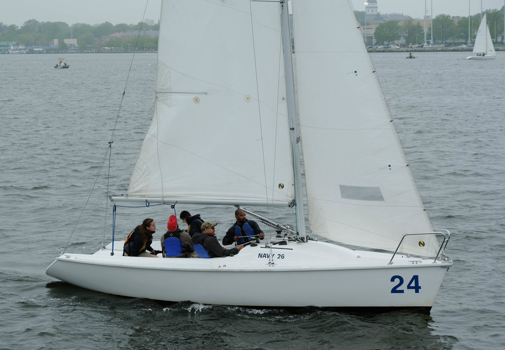 The crew on this Navy 26 get settled in before the first race starts. It is all new to the veterans on this boat.