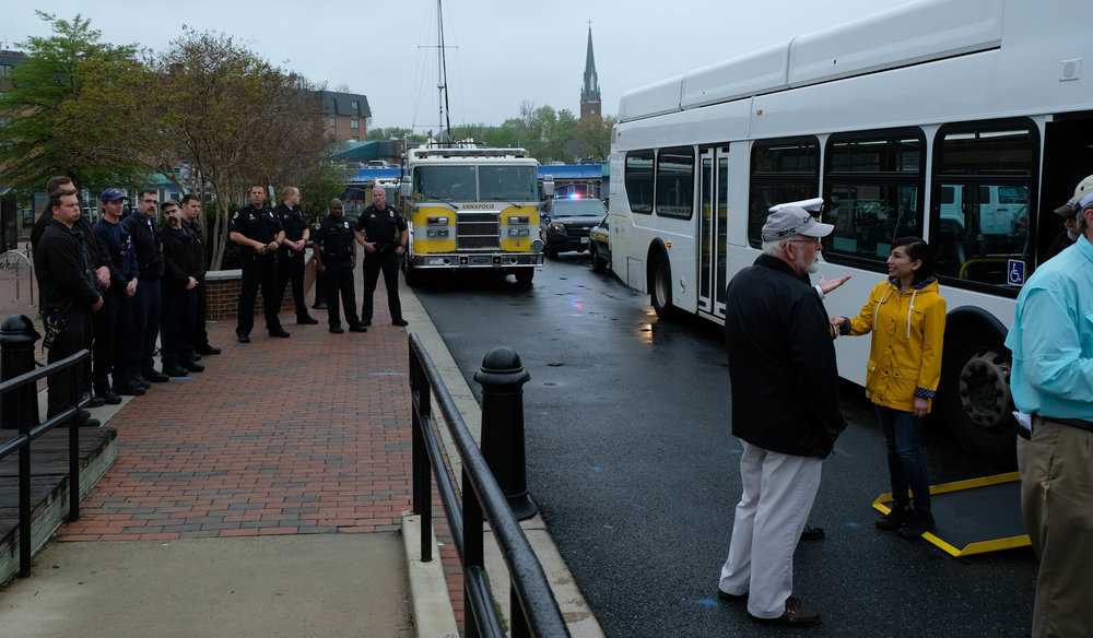 The police officers and firemen stand by to show respect for those coming off the bus. They understand what has been given in the service of our country, and it is a very serious moment of brothers in arms.