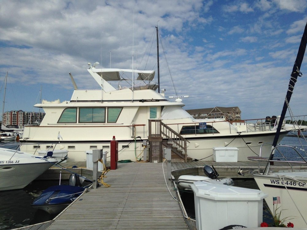Larger than your typical cruising boat, this Hatteras needs outside assistance for crew to board easily. You get the idea of why this is not a good thing, right?