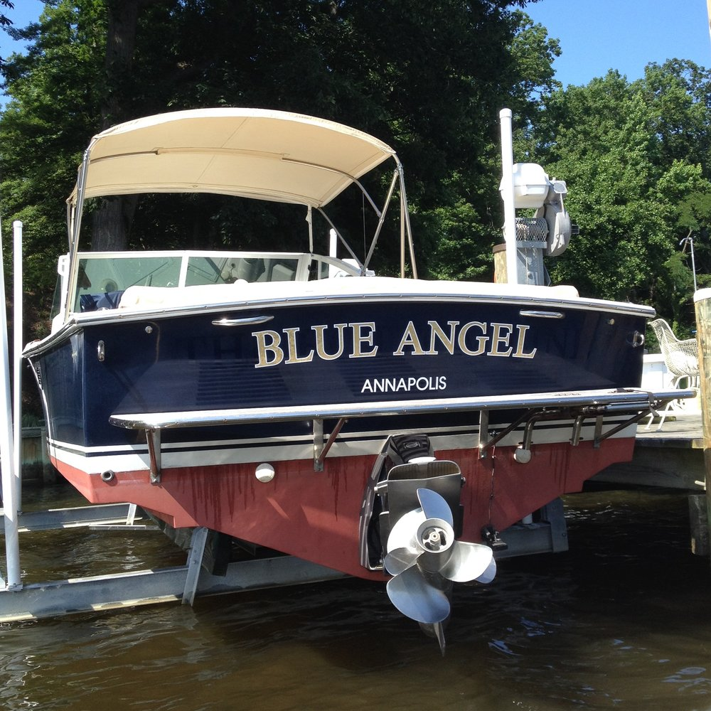 Soon after we bought  Blue Angel , all bright and shiny, only a couple of years ago. Note the two handholds on the transom.