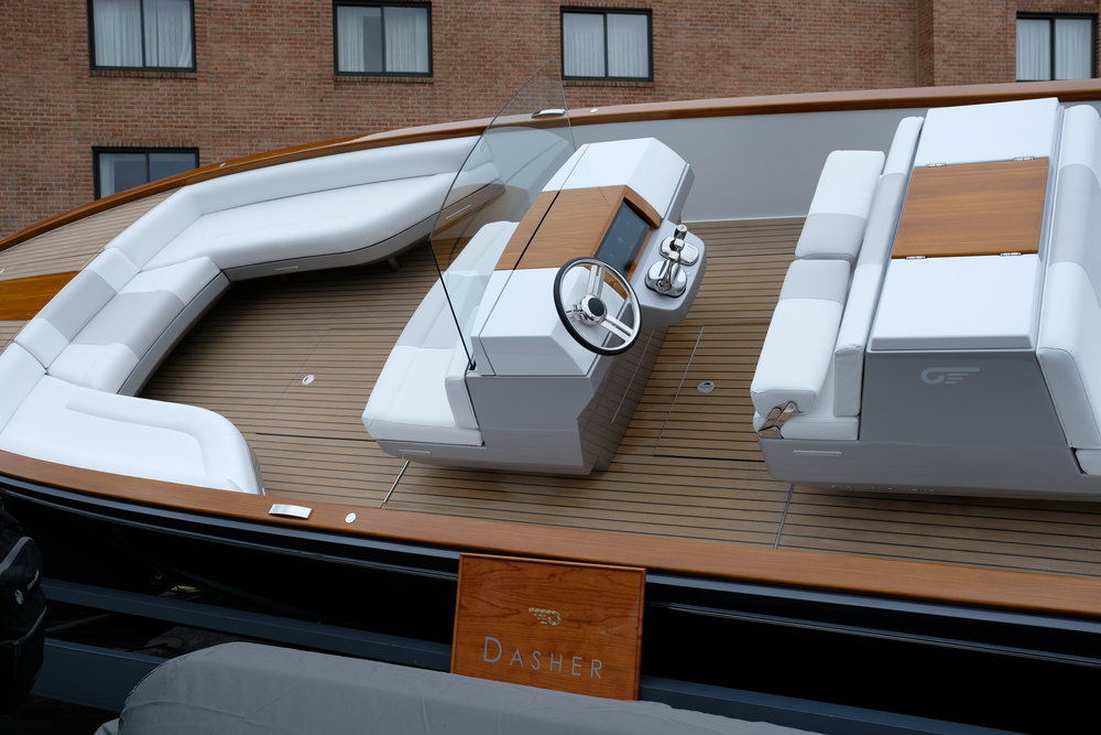 The Hinckley Dasher is an electric cocktail cruiser using two Torqeedo inboard motors. This is a high-tech powerboat. And there is no wood on this boat, despite what you see. The ultimate illusion.